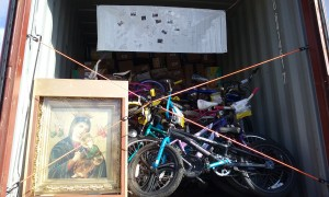 Our Mother of Perpetual Help, patroness of Haiti, is placed at the entrance of the sea container, along with the signatures and well wishes of all those who helped today.